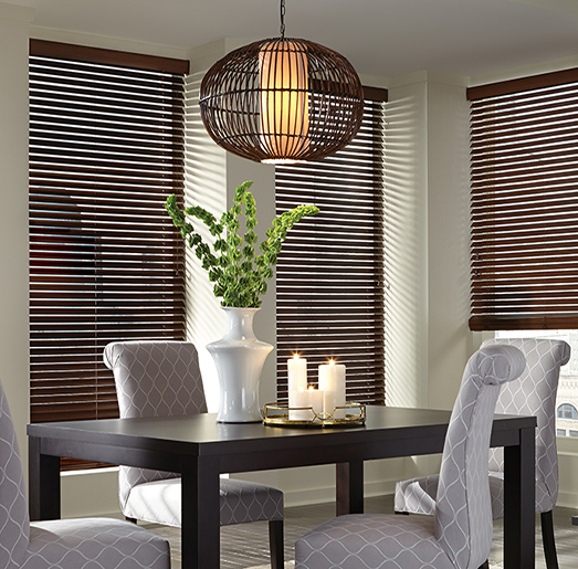 black horizontal shades in a dining room